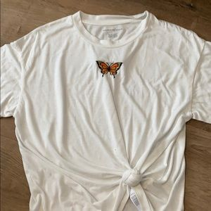 Oversized white tee with butterfly embroidery